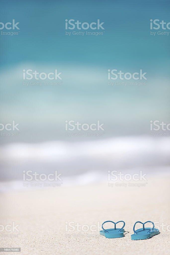 Flip flops on a tropical beach royalty-free stock photo
