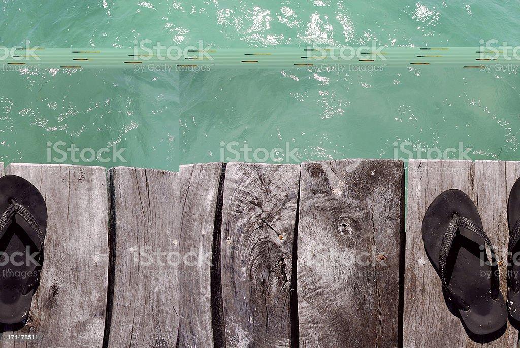 Flip flops on the beach royalty-free stock photo