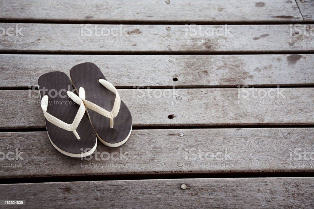 Flip flops on the decking royalty-free stock photo