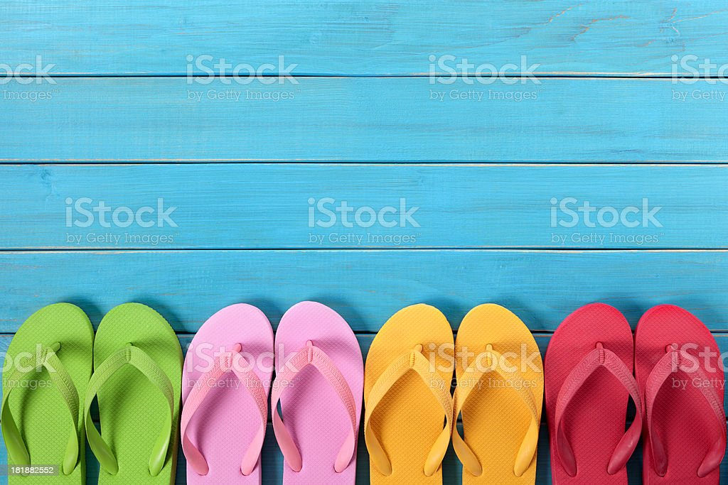 Flip flops with blue decking royalty-free stock photo