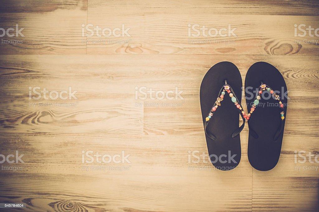 Flip-flop on deck stock photo