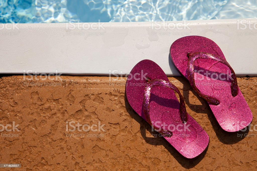 Flip-flops at Pool royalty-free stock photo