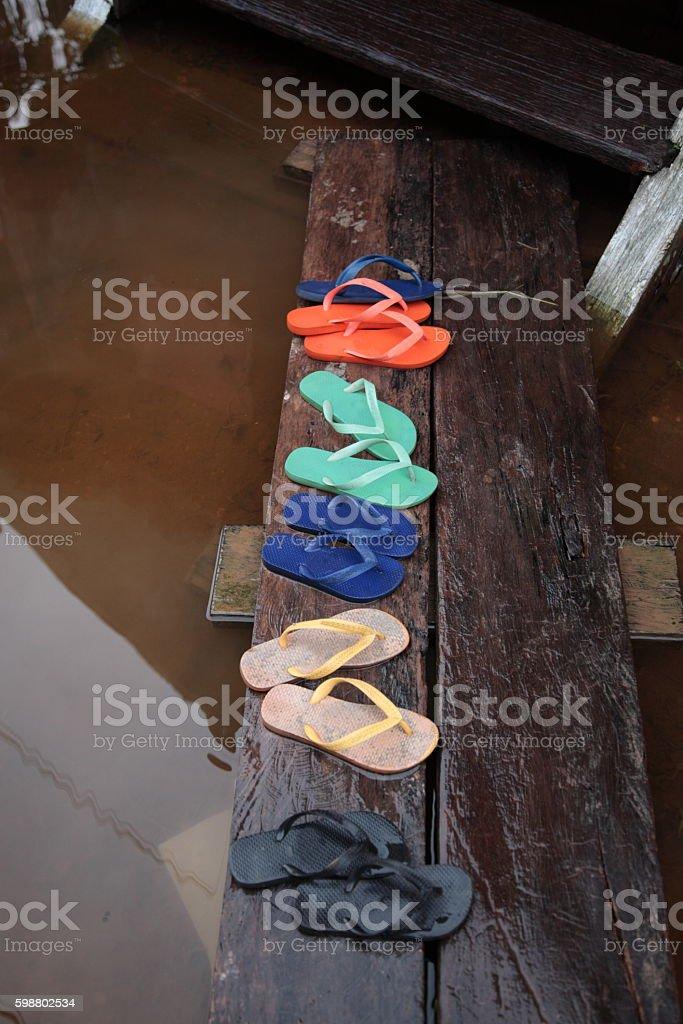 Flip-flops on deck in Amazon jungle river, Brazil stock photo