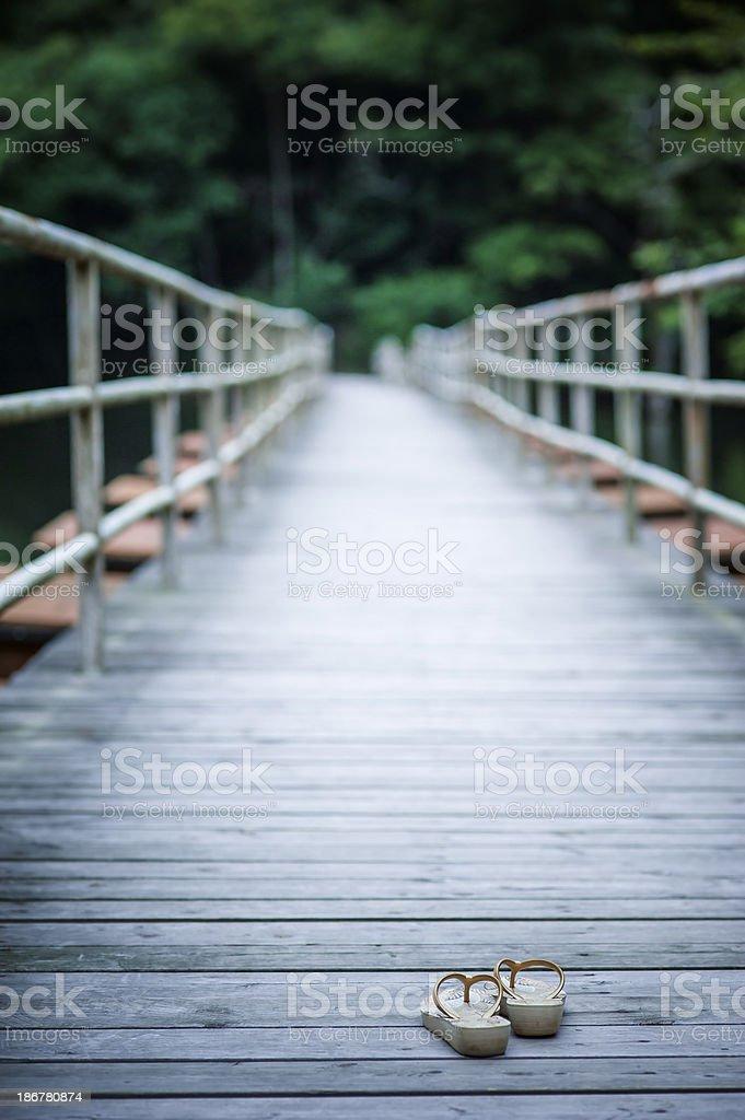 Flip-flops on Footbridge stock photo