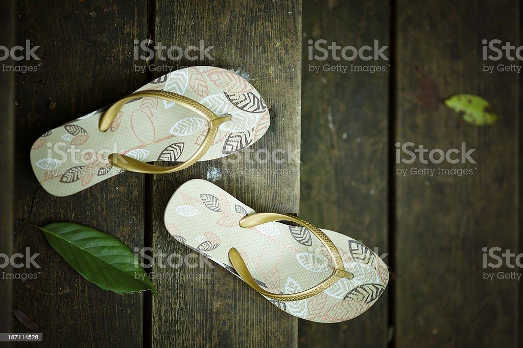Flip-flops on Wooden Plank stock photo