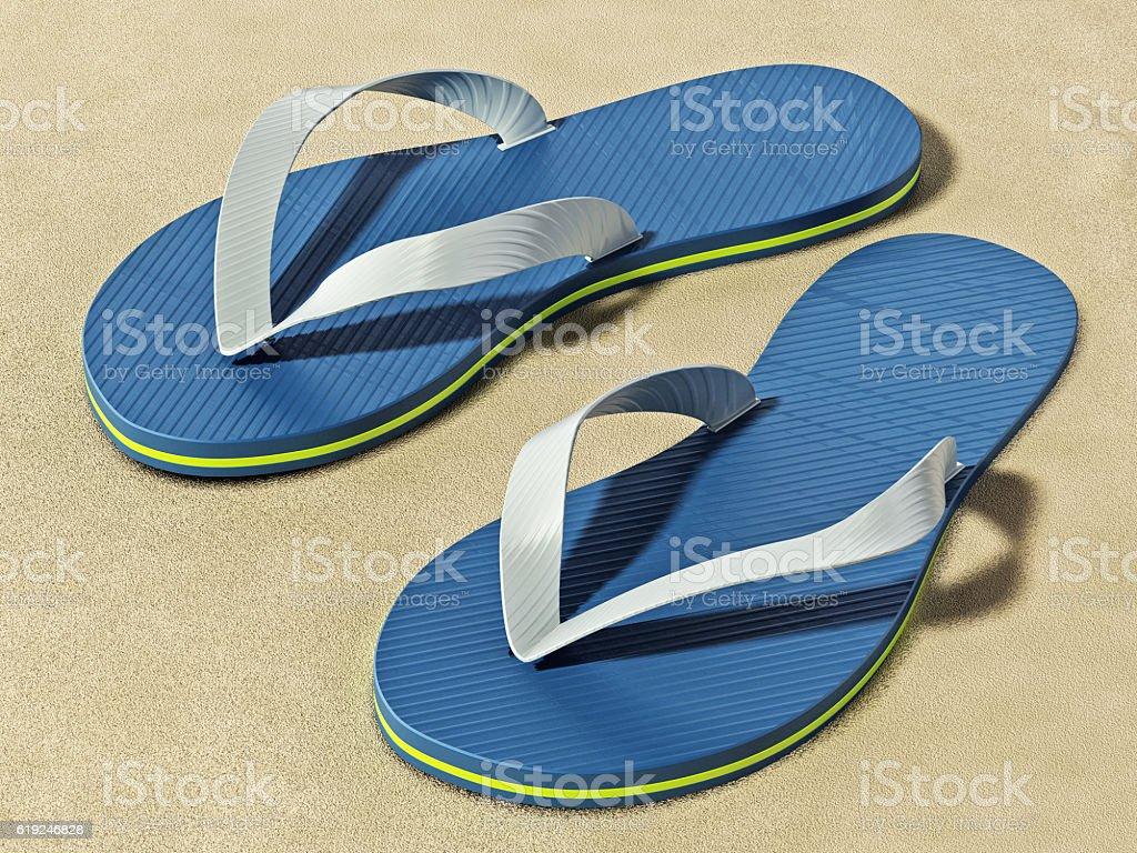 Flip-flops standing on beach sand stock photo