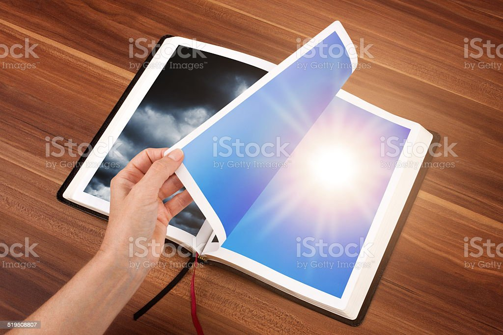 Fliping the page for a change stock photo