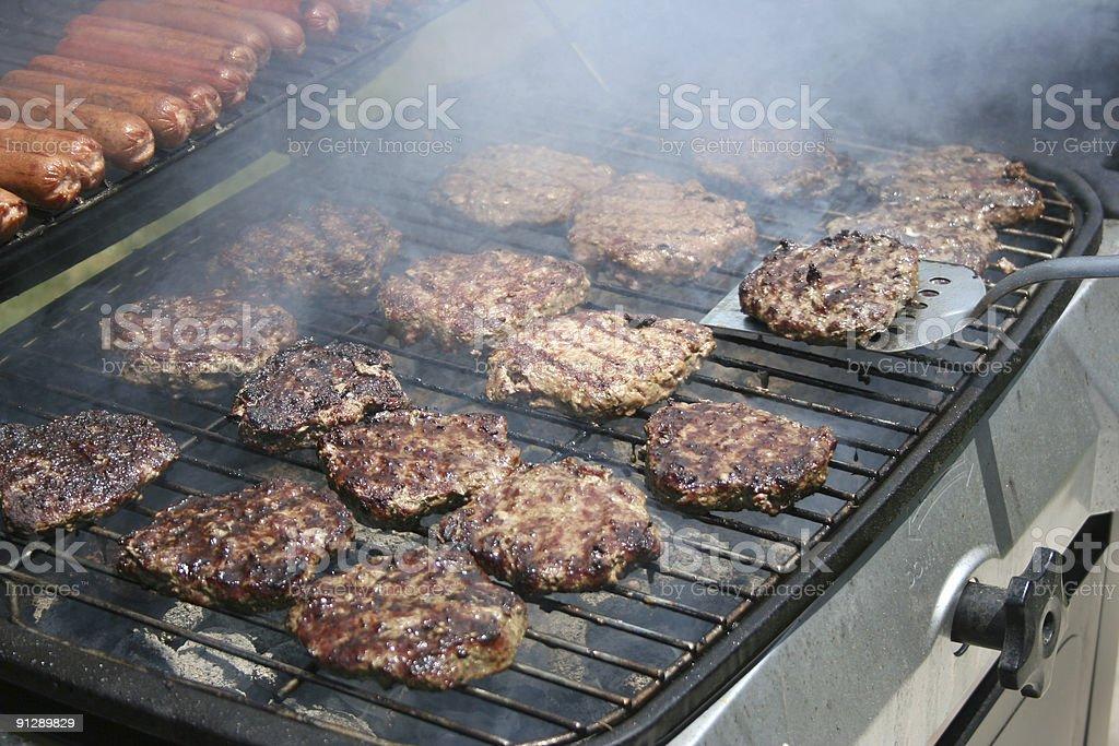 Flipping a Burger stock photo