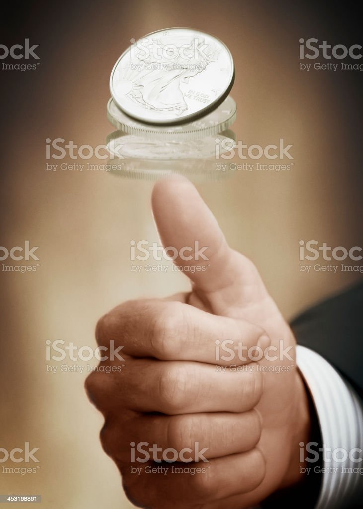 Flipping A Coin stock photo