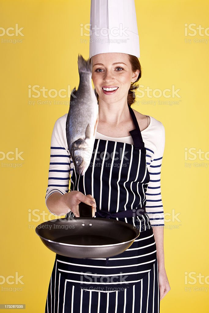 Flipping a fish. royalty-free stock photo