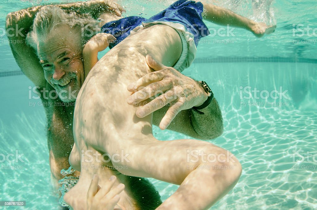 Flipping for Grandpa underwater in summer stock photo