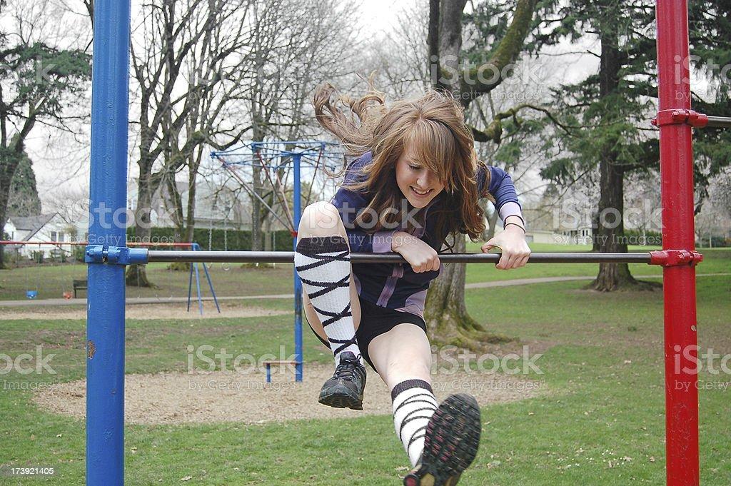 Flipping on Monkey Bars stock photo