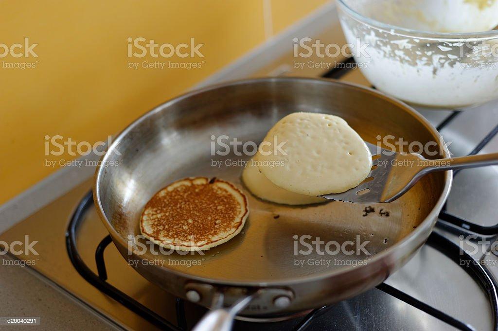 Flipping Pancakes stock photo
