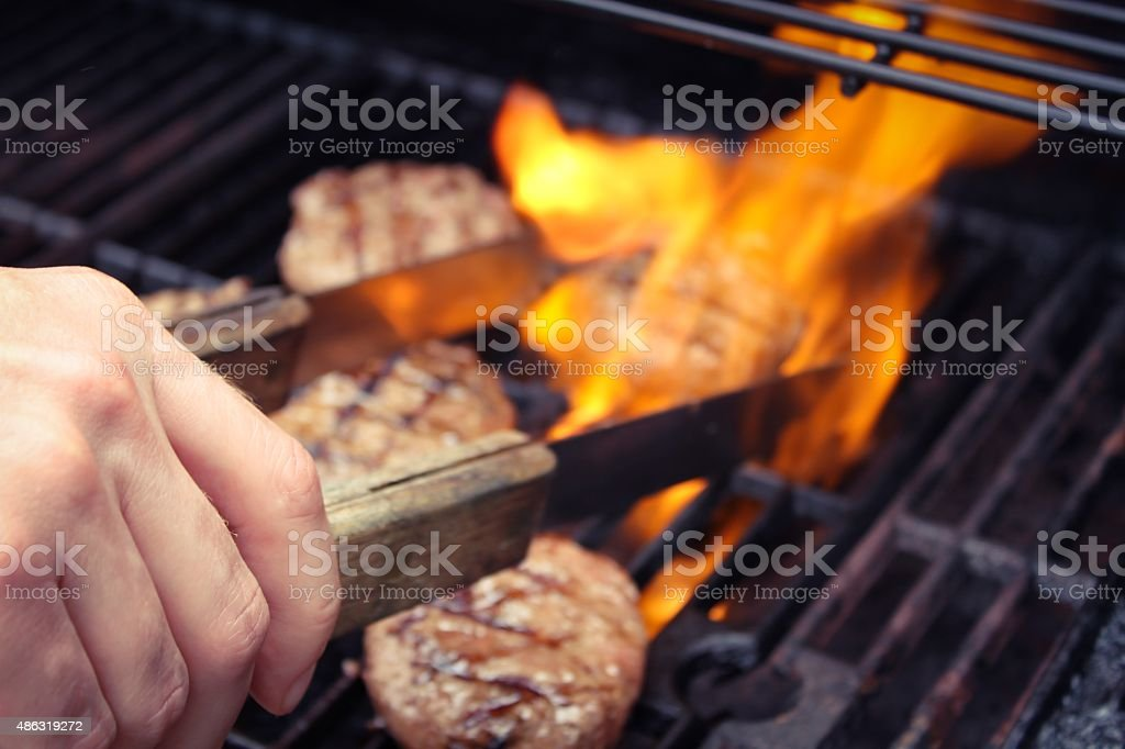 Flipping the burgers stock photo