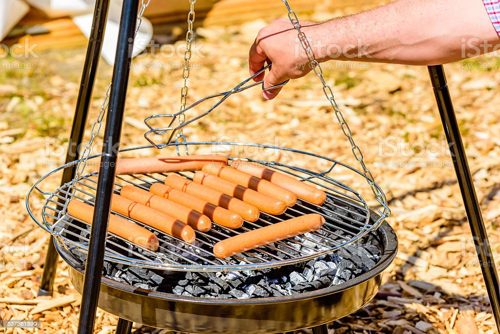 Flipping the hot dogs stock photo