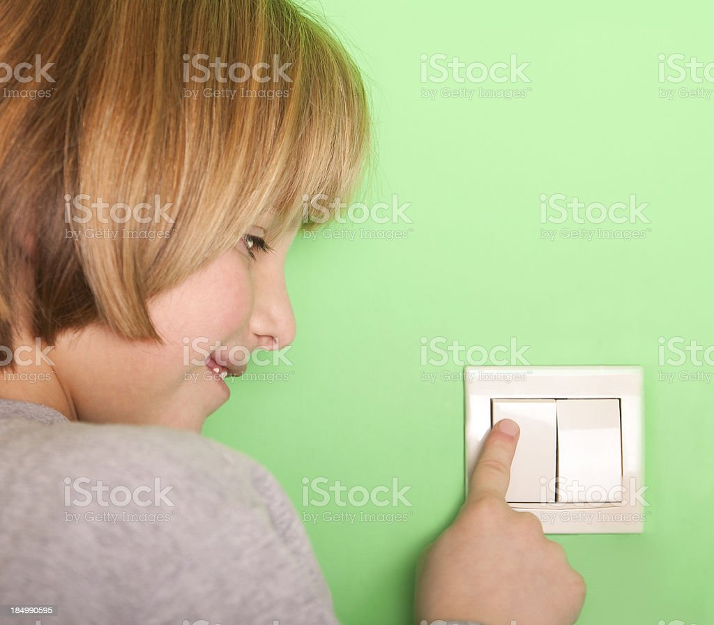 Flipping the switch stock photo