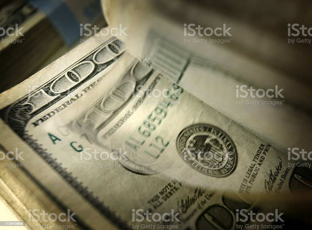 Flipping through a stack of one hundred dollar bill stock photo