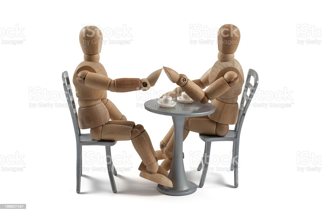 Flirt at coffee house - wooden mannequin with date stock photo