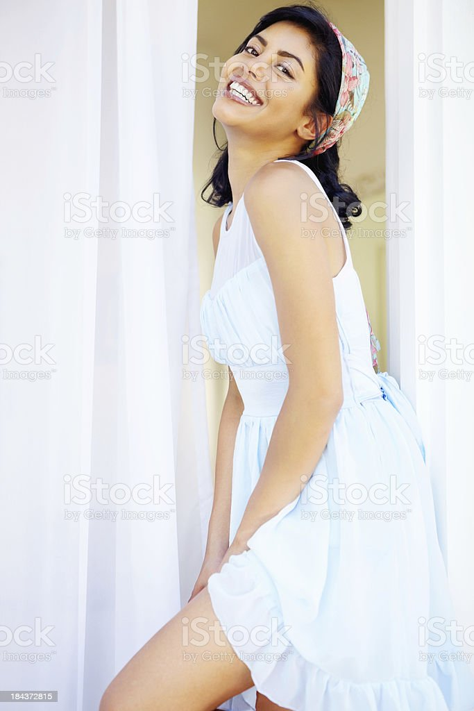 Flirtatious woman smiling stock photo