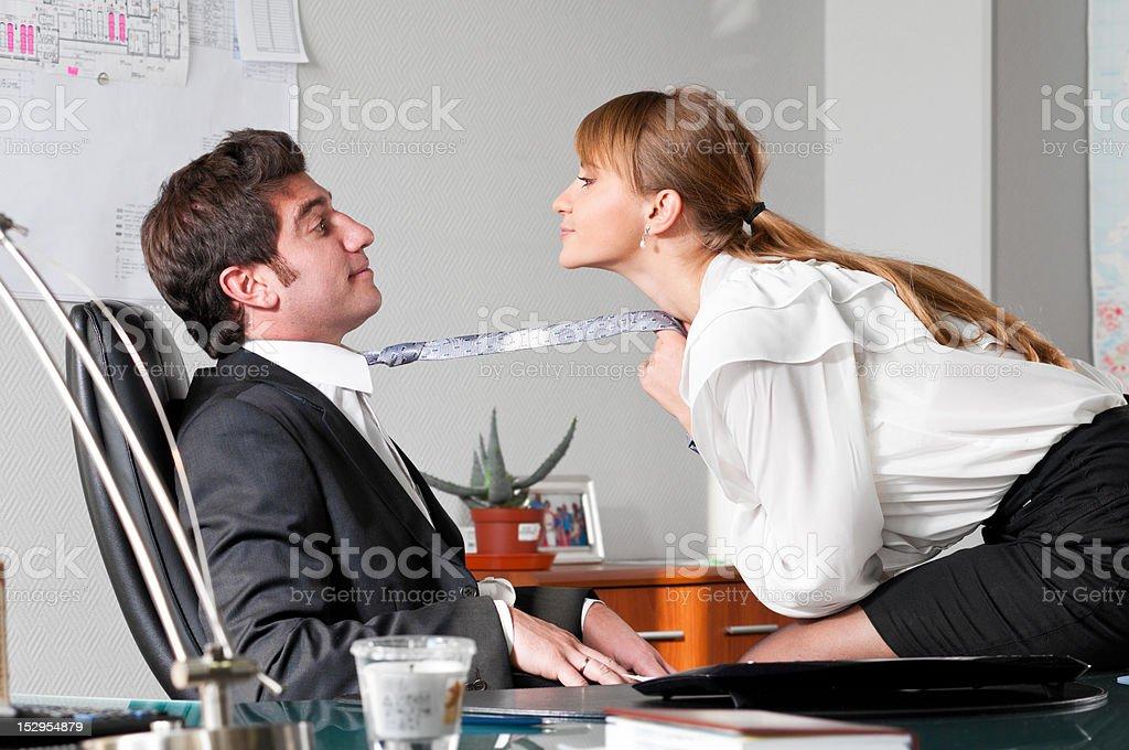 flirting at work stock photo