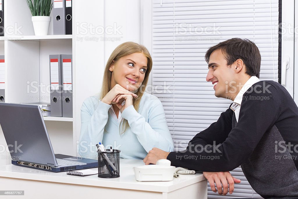 Flirting at work stock photo