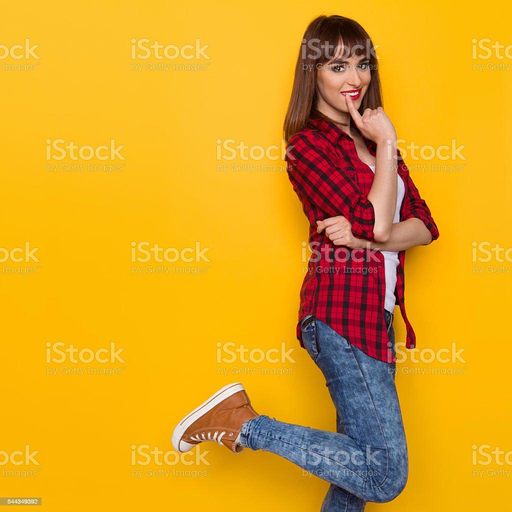 Flirting Girl Standing On One Leg stock photo