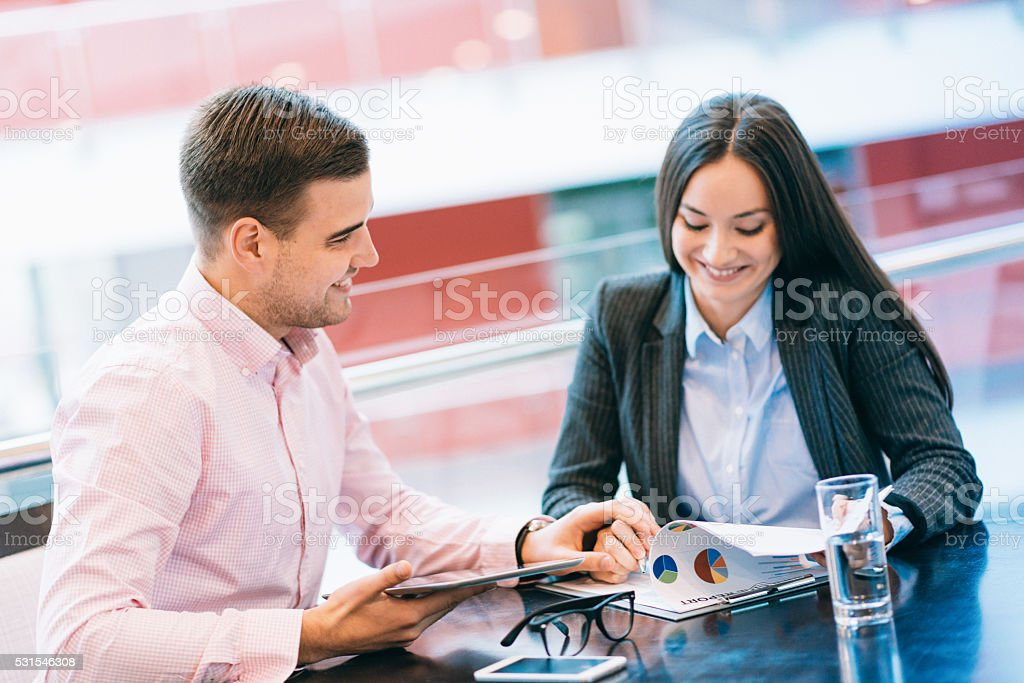 Flirting in office betwwen colleagues during working hours stock photo