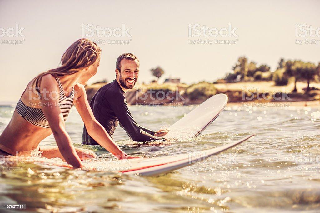 Flirting on their surfboards stock photo