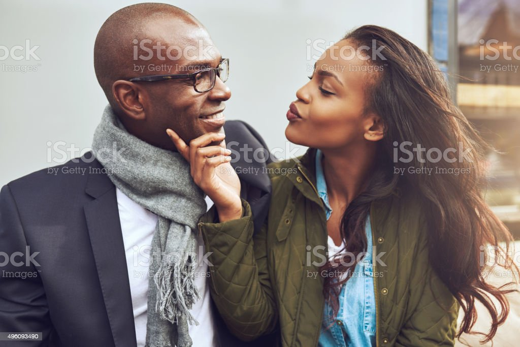 Flirting young African American woman stock photo