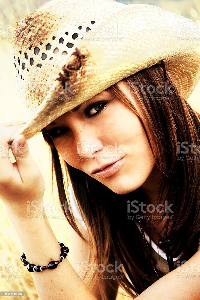 Flirty Cowgirl Tipping Hat stock photo