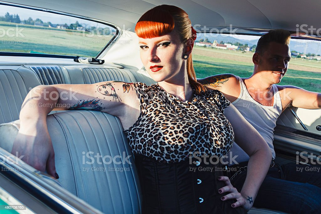 Flirty pin-up girl and teddy boy stock photo