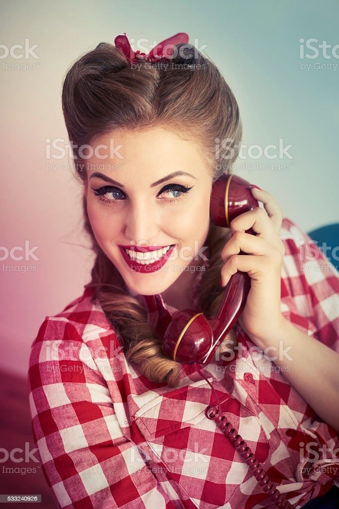 Flirty talk of pin up girl stock photo