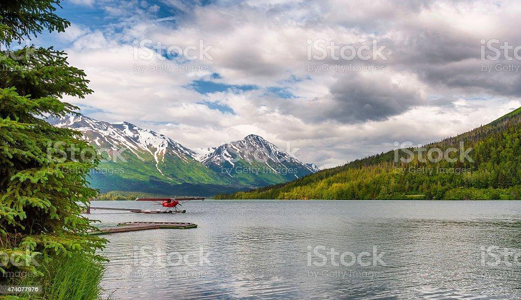 Float Plane Docked on Moose Lake in Alaska stock photo