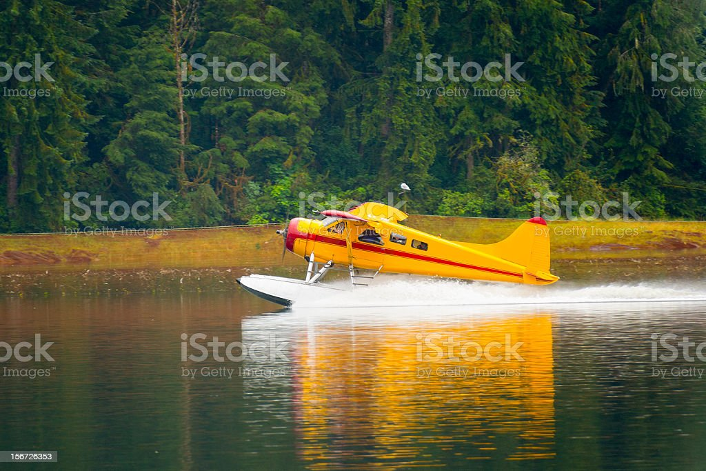 Float Plane lands on the water stock photo