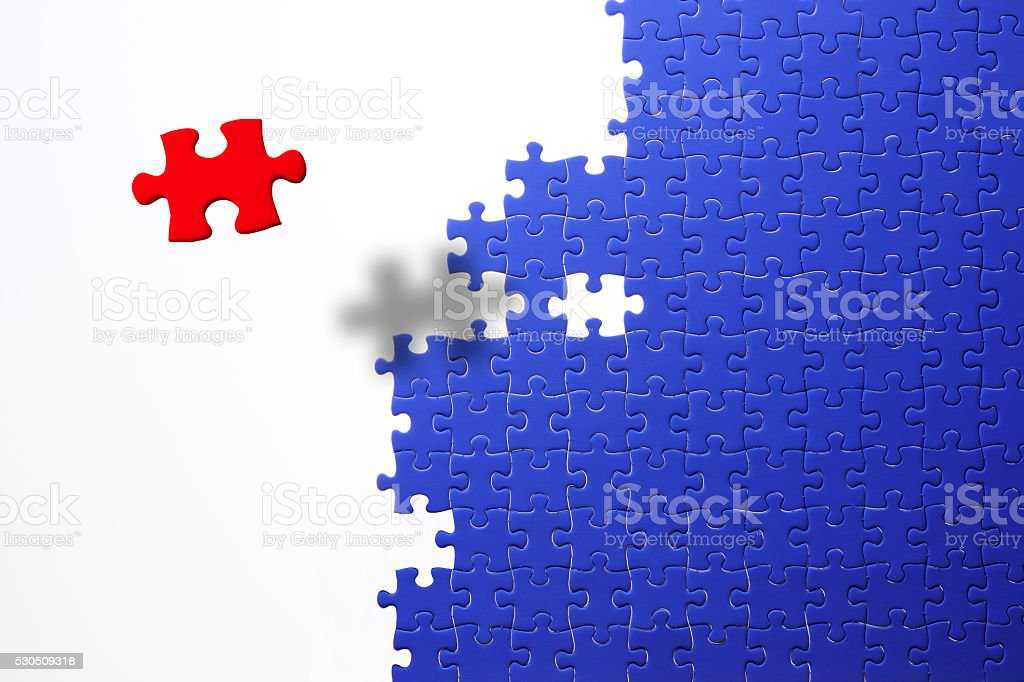 Floating a red jigsaw puzzle against blue jigsaw puzzle stock photo