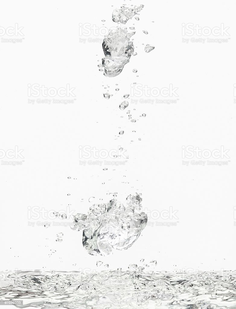 Floating air bubbles and water surface royalty-free stock photo