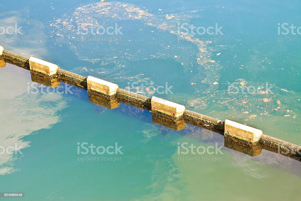 Floating anti pollution barrier in modular plastic elements stock photo