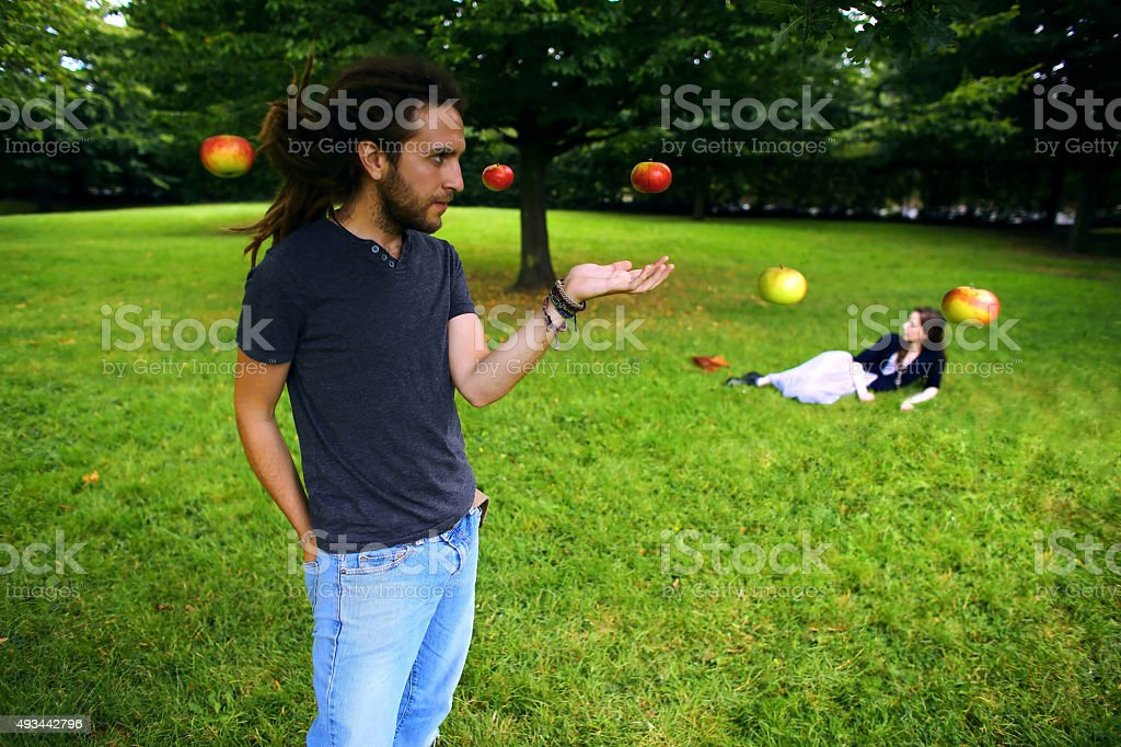 Floating apples in the park stock photo