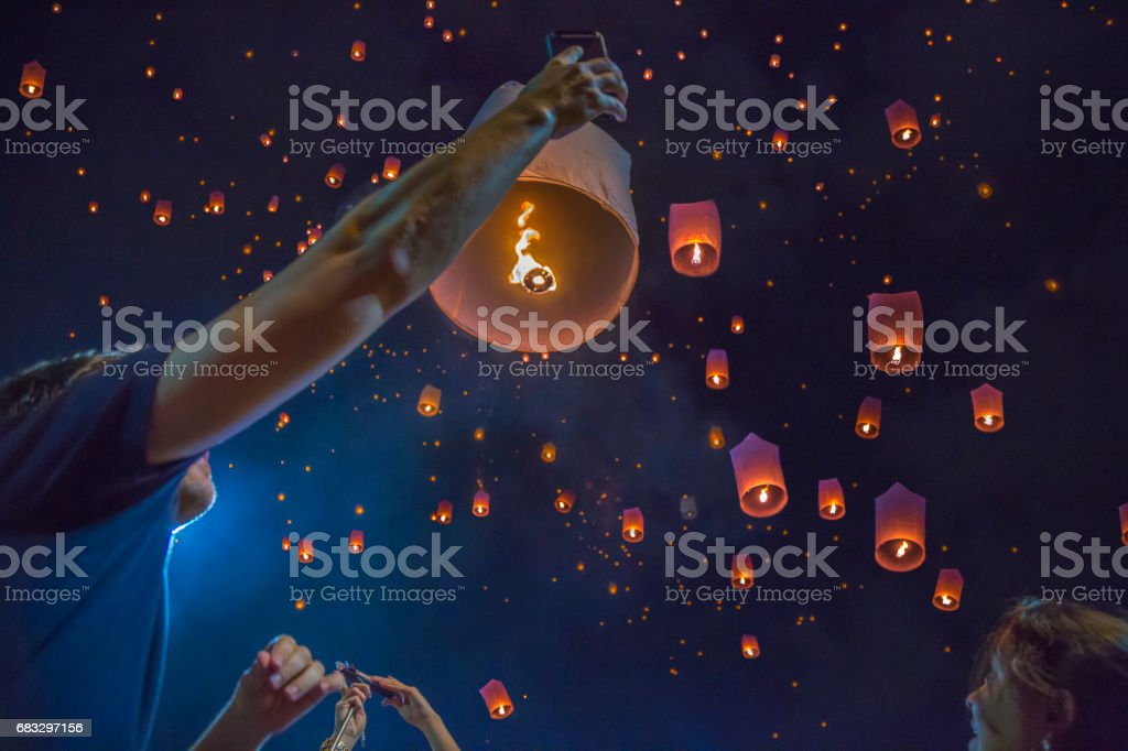 Floating asian lanterns in the sky of Chiang Mai, Thailand stock photo