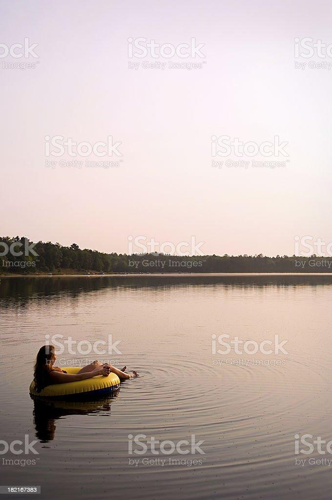 floating at sunrise royalty-free stock photo