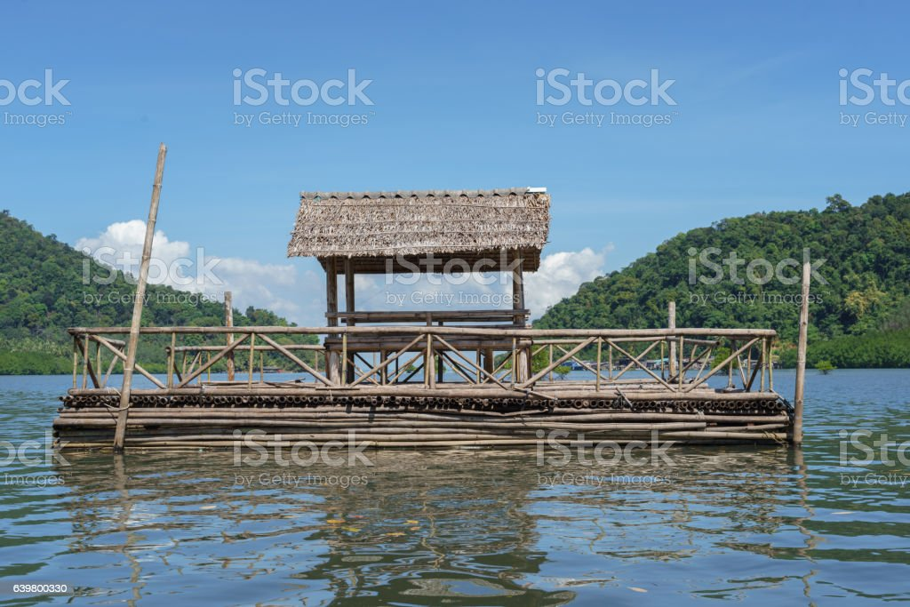 Floating bamboo raft in the bay stock photo