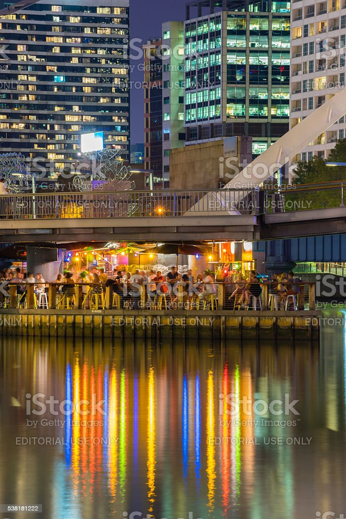 Floating bar full of people in Melbourne at night stock photo