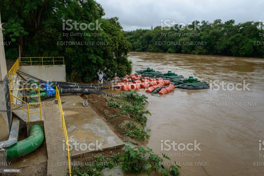 Floating barge pumps, Paraíba river, Brazil stock photo