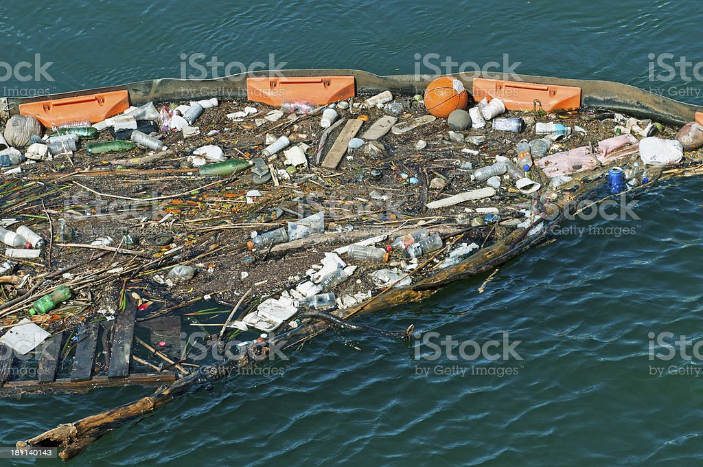 Floating barrier for containment of debris in Hawaii stock photo