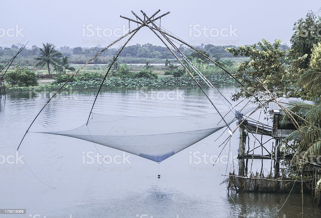 floating basket for keeping live fish in water royalty-free stock photo