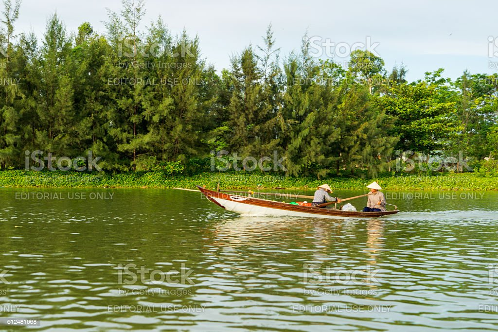Floating boats on Thu Bon river near ancient Hoi An stock photo