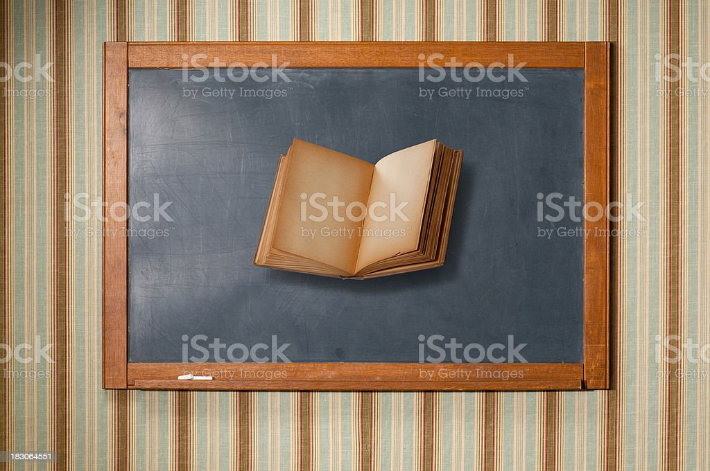 Floating Book On Blackboard stock photo