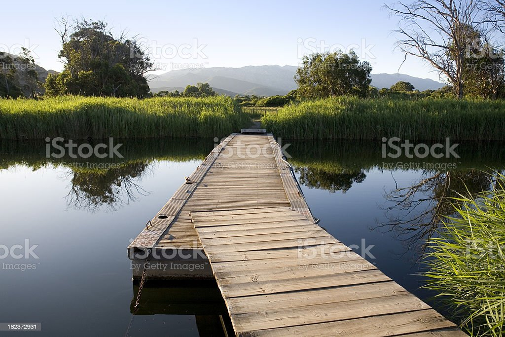Floating bridge on the river royalty-free stock photo