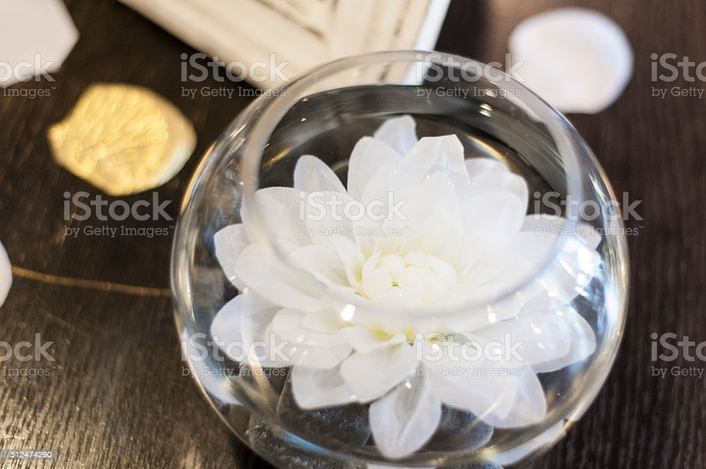 Floating candle in glass bowl stock photo