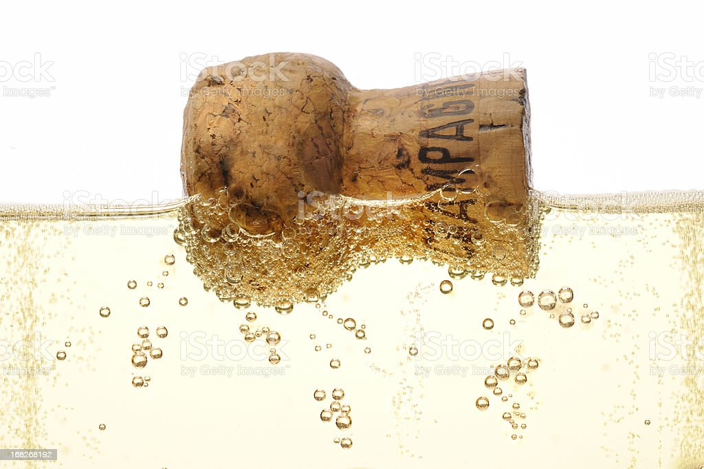 floating champagne cork in flute stock photo